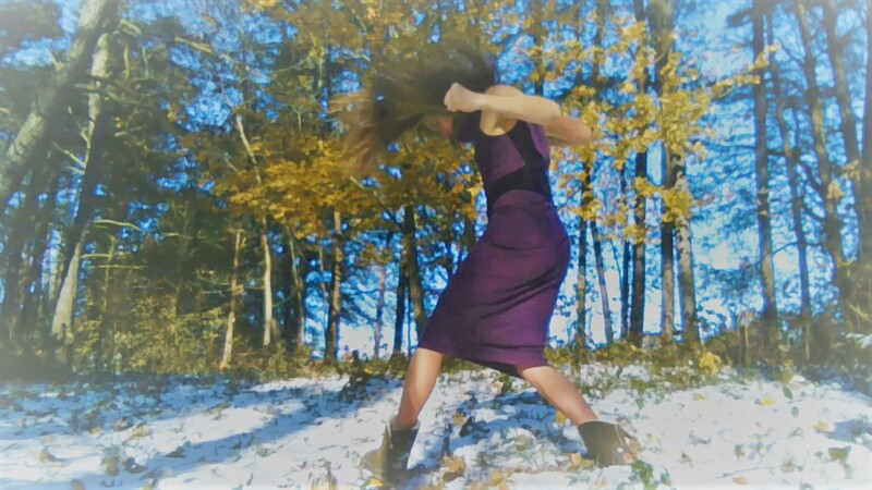 Choreographer, Tessa Priem, doing dance improvisation outdoors