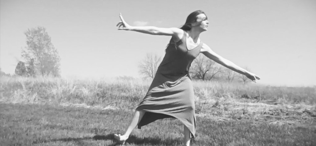 Solo dance artist, Tessa Priem, dancing outside in the month of April